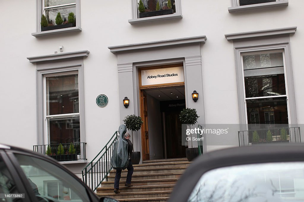A musician enters Abbey Road Studios in St John's Wood on March 5, 2012 in London, England. Abbey Road in North London has been made famous by 1960s bands such as The Beatles and Pink Floyd who recorded in Abbey Road Studios. In particular, the cover of The Beatles' 1969 album 'Abbey Road' features the band on the pedestrian zebra crossing outside the studio. The crossing has become a popular destination for Beatles fans from around the world.