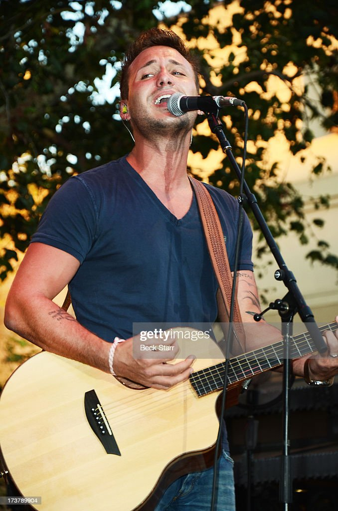 Musician Eric Gunderson of Love And Theft performs at The 2013 Summer Concert Series at The Grove on July 17, 2013 in Los Angeles, California.