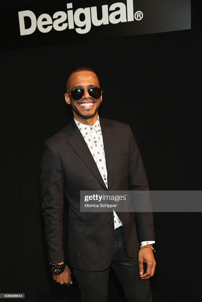 Musician Eric West poses backstage at Desigual fashion show during Fall 2016 New York Fashion Week: The Shows at The Arc, Skylight at Moynihan Station on February 11, 2016 in New York City.