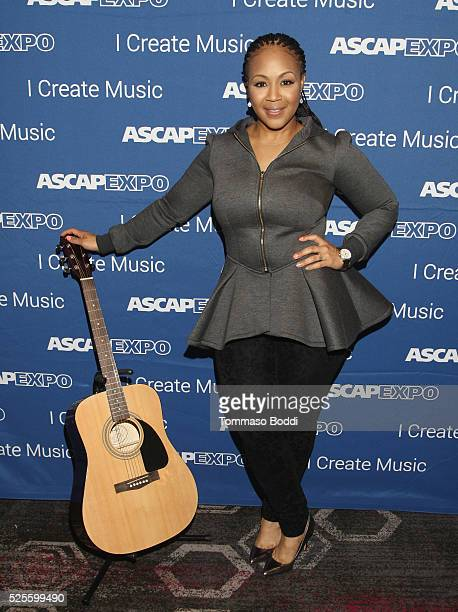 Musician Erica Campbell poses with a #StandWithSongwriters guitar which will be presented in May to members of Congress to urge them to support...