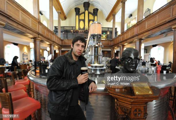 Musician Example poses in 'The Church' along side a bust of Arthur Guinness ahead of the Guinness Arthur's Day celebrations on September 26 2012 in...
