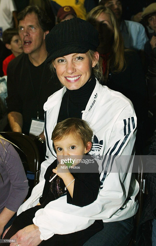 Musician Faith Hill and her daughter Audrey Caroline watch the Celebrity Game at NBA Jam Session during the 2003 NBA All Star Weekend at the Georgia...