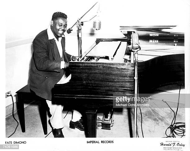 RB musician Fats Domino poses for a portrait at the piano in circa 1956