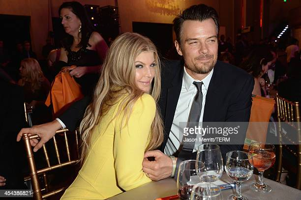 Musician Fergie and actor Josh Duhamel attend 'TrevorLIVE LA' honoring Jane Lynch and Toyota for the Trevor Project at Hollywood Palladium on...