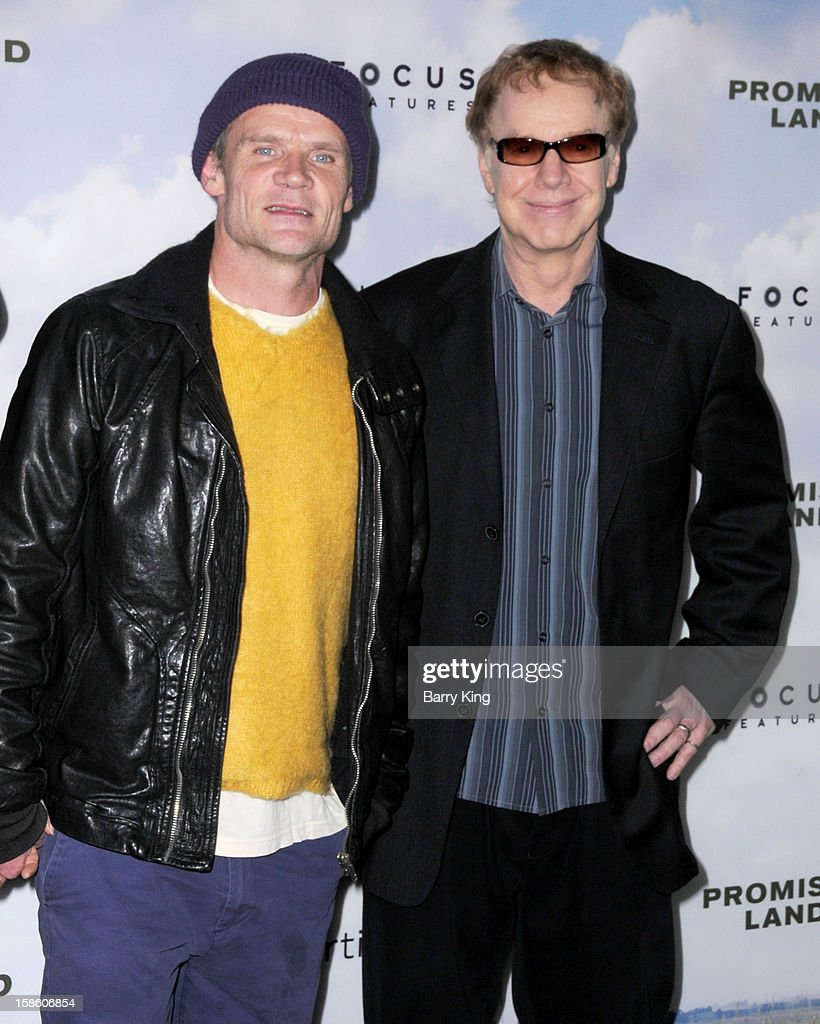 Musician Flea (L) and composer Danny Elfman arrive at the Los Angeles premiere of 'Promised Land' held at Directors Guild Of America on December 6, 2012 in Los Angeles, California.