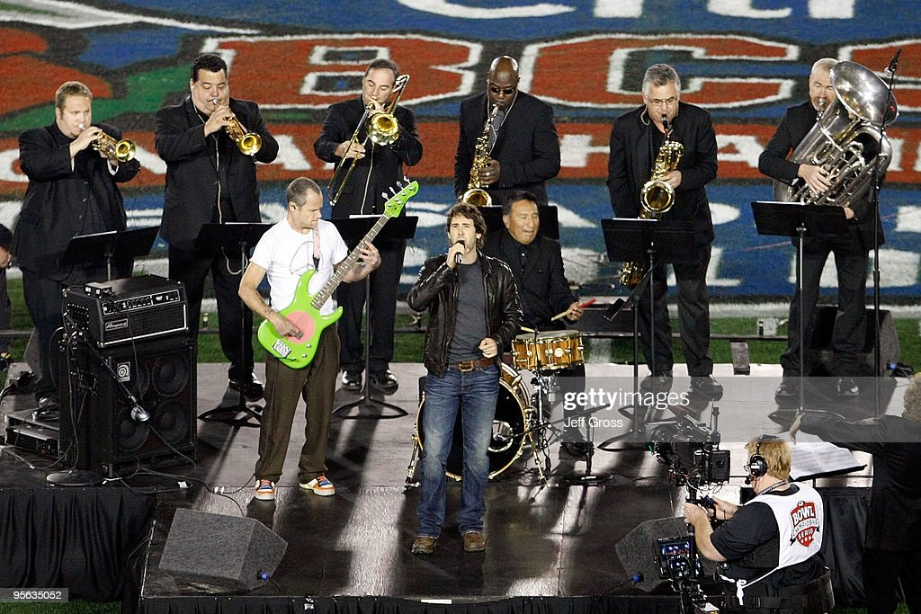 Musician Flea and singer Josh Groban perform the national anthem prior to the Citi BCS National Championship game between the Texas Longhorns and the...