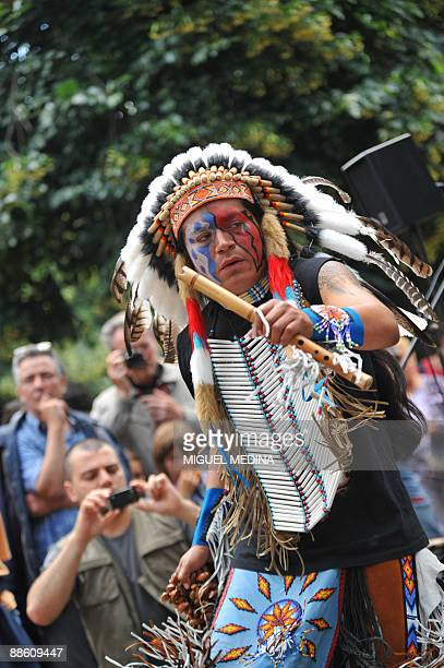 A musician from a band dressed with Indian native American suits performs on June 21 2009 in Paris during the annual music event 'La Fete de la...