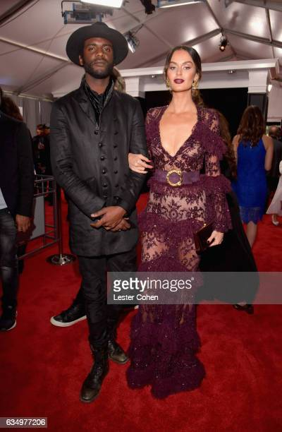 Musician Gary Clark Jr and model Nicole Trunfio attend The 59th GRAMMY Awards at STAPLES Center on February 12 2017 in Los Angeles California