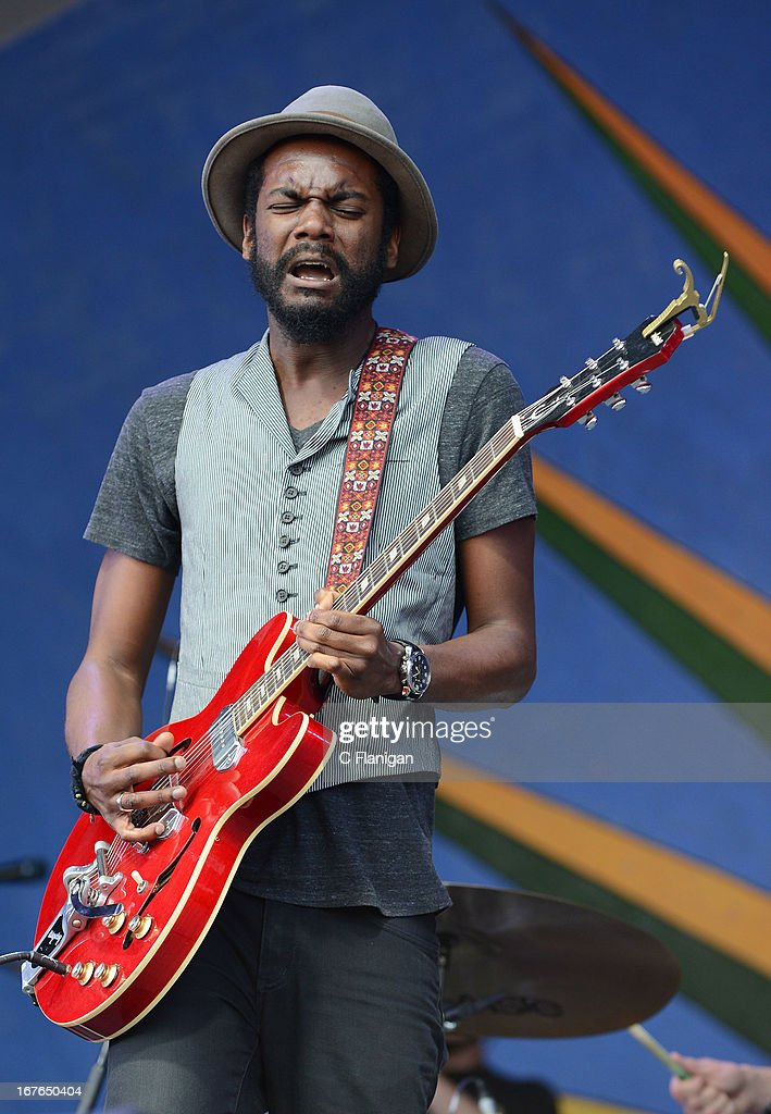 Musician <a gi-track='captionPersonalityLinkClicked' href=/galleries/search?phrase=Gary+Clark+Jr.&family=editorial&specificpeople=4495733 ng-click='$event.stopPropagation()'>Gary Clark Jr.</a> performs during the 2013 New Orleans Jazz and Heritage Festival at Fair Grounds Race Course on April 26, 2013 in New Orleans, Louisiana.