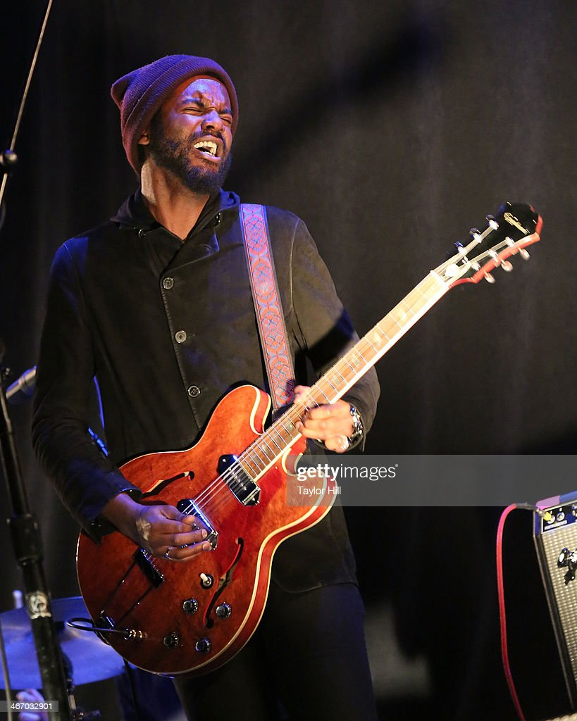 Musician <a gi-track='captionPersonalityLinkClicked' href=/galleries/search?phrase=Gary+Clark+Jr.&family=editorial&specificpeople=4495733 ng-click='$event.stopPropagation()'>Gary Clark Jr.</a> performs in concert during the 'Mechanical Bull' tour at Philips Arena on February 5, 2014 in Atlanta, Georgia.