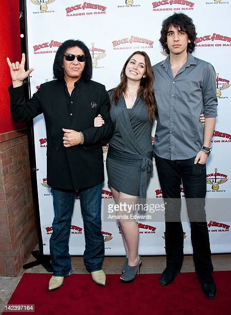 Musician Gene Simmons and his children Sophie Simmons and Nick Simmons arrive at the Rock Brews opening night party at Rock Brews on April 3 2012 in...