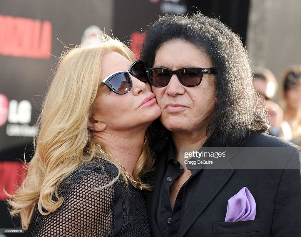 Musician <a gi-track='captionPersonalityLinkClicked' href=/galleries/search?phrase=Gene+Simmons&family=editorial&specificpeople=138593 ng-click='$event.stopPropagation()'>Gene Simmons</a> and <a gi-track='captionPersonalityLinkClicked' href=/galleries/search?phrase=Shannon+Tweed&family=editorial&specificpeople=226528 ng-click='$event.stopPropagation()'>Shannon Tweed</a> arrive at the Los Angeles premiere of 'Godzilla' at Dolby Theatre on May 8, 2014 in Hollywood, California.