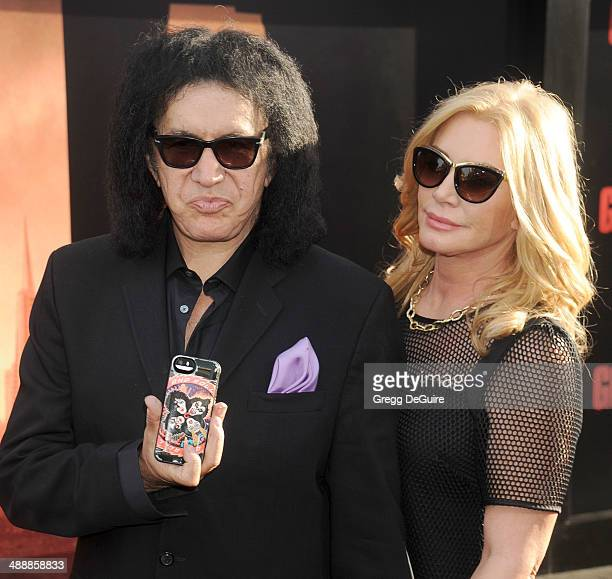 Musician Gene Simmons and Shannon Tweed arrive at the Los Angeles premiere of 'Godzilla' at Dolby Theatre on May 8 2014 in Hollywood California
