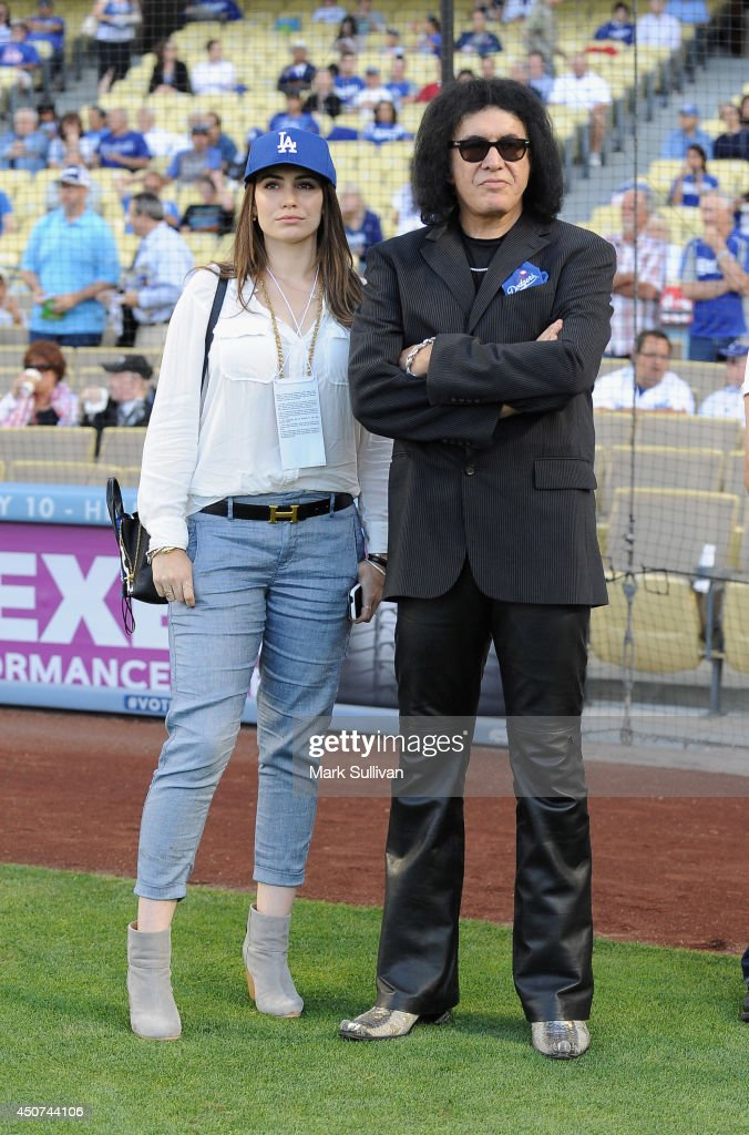 Musician Gene Simmons and Sophie Simmons waits to sing the national anthem before the game between the Colorado Rockies and Los Angeles Dodgers at...