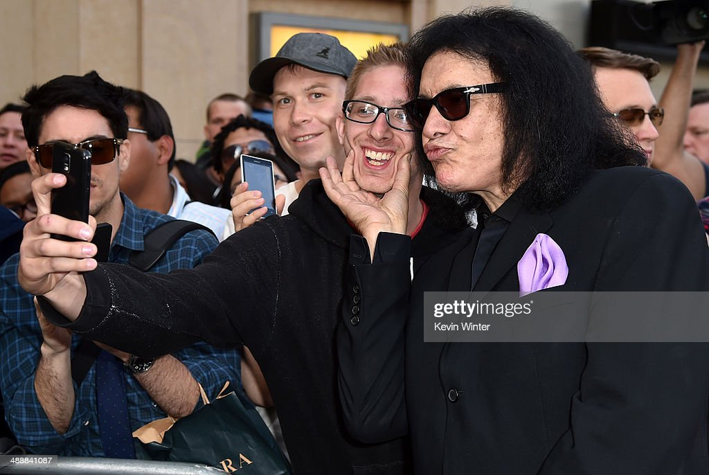 Musician <a gi-track='captionPersonalityLinkClicked' href=/galleries/search?phrase=Gene+Simmons&family=editorial&specificpeople=138593 ng-click='$event.stopPropagation()'>Gene Simmons</a> attends the premiere of Warner Bros. Pictures and Legendary Pictures' 'Godzilla' at Dolby Theatre on May 8, 2014 in Hollywood, California.