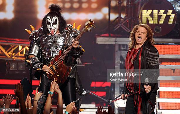 Musician Gene Simmons of KISS and American Idol Finalist Caleb Johnson perform onstage during Fox's 'American Idol' XIII Finale at Nokia Theatre LA...