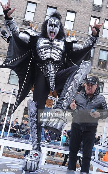 Musician Gene Simmons of KISS and Doc McGhee attends the 88th Annual Macys Thanksgiving Day Parade at on November 27 2014 in New York New York