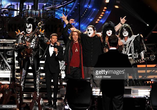 Musician Gene Simmons of KISS host Ryan Seacrest American Idol Finalist Caleb Johnsonj brother Houston Johnson musicians Paul Stanley and Tommy...