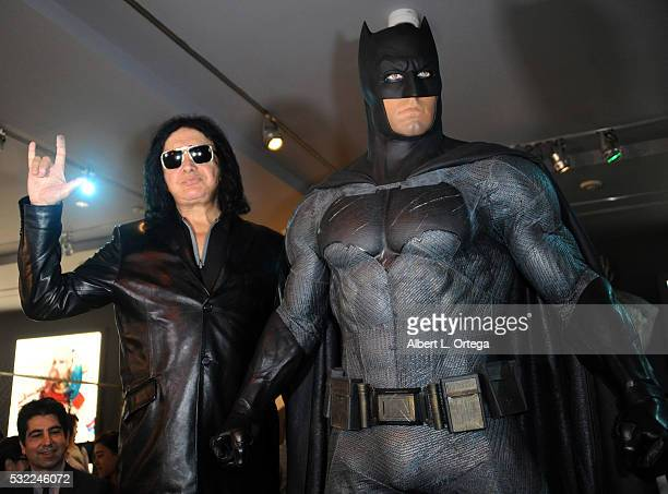 Musician Gene Simmons of KISS poses with the Batman costume worn by Ben Affleck in 'Superman V Batman' at the Warner Bros Studio Tour Hollywood...