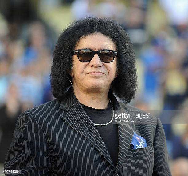 Musician Gene Simmons sings the national anthem before the game between the Colorado Rockies and Los Angeles Dodgers at Dodger Stadium on June 16...