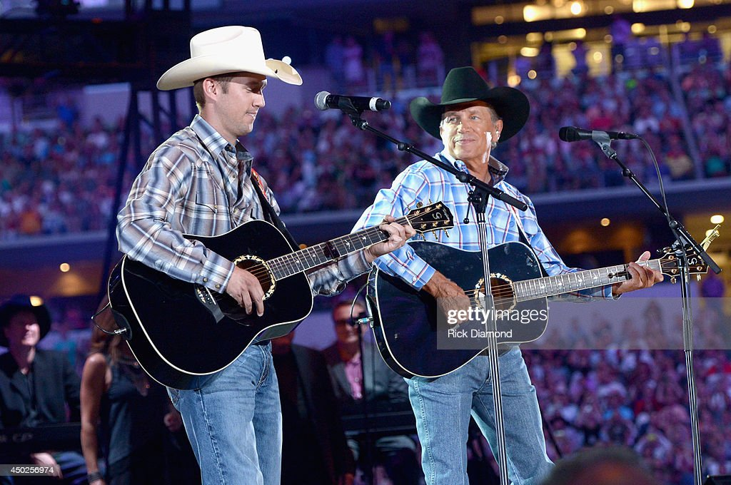 Musician George Strait and his son Bubba Strait perform onstage at George Strait's 'The Cowboy Rides Away Tour' final stop at ATT Stadium at ATT...