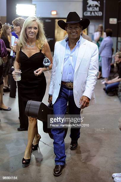 Musician George Strait and Norma Strait walk backstage during Brooks Dunn's The Last Rodeo Show at the MGM Grand Garden Arena on April 19 2010 in Las...