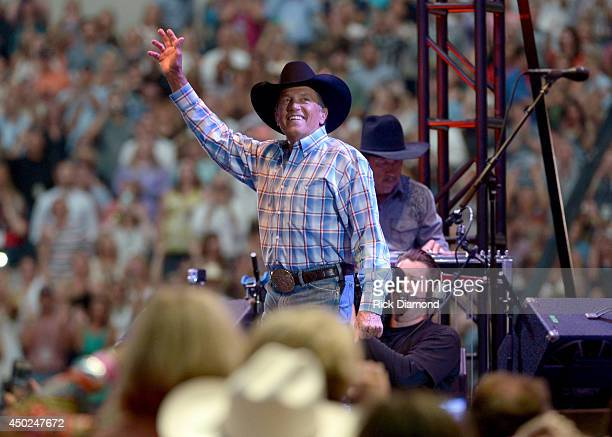 Musician George Strait performs onstage at George Strait's 'The Cowboy Rides Away Tour' final stop at ATT Stadium at ATT Stadium on June 7 2014 in...