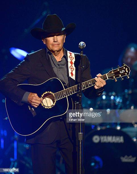 Musician George Strait performs onstage during the 48th Annual Academy of Country Music Awards at the MGM Grand Garden Arena on April 7 2013 in Las...