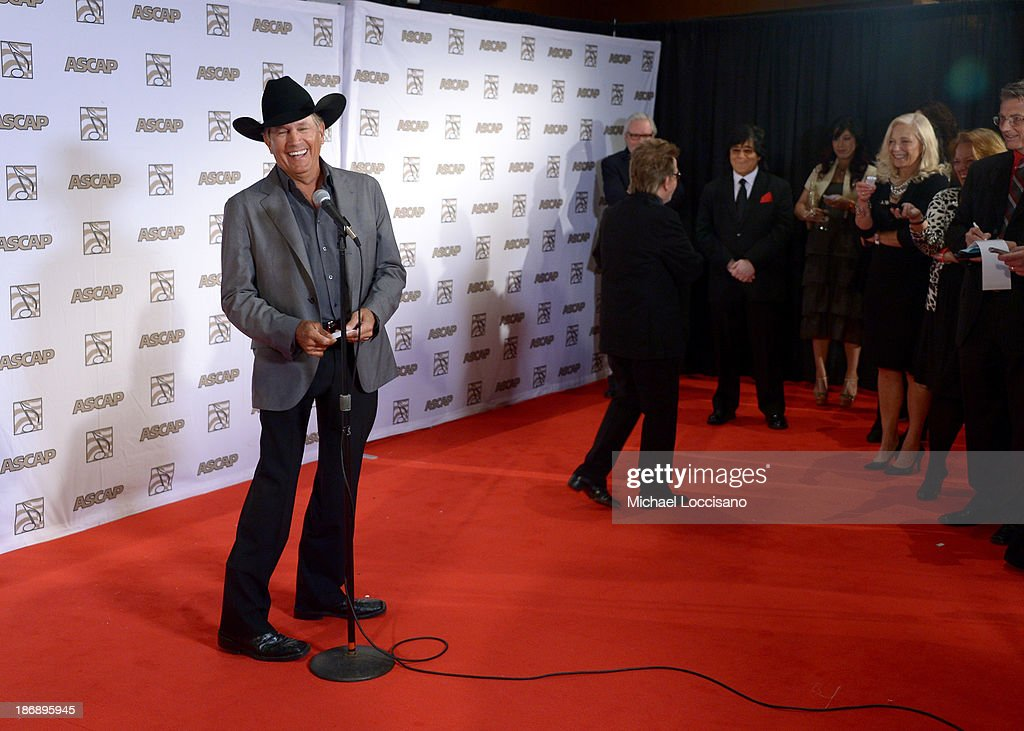 Musician <a gi-track='captionPersonalityLinkClicked' href=/galleries/search?phrase=George+Strait&family=editorial&specificpeople=234588 ng-click='$event.stopPropagation()'>George Strait</a> speaks during a press conference at the 51st annual ASCAP Country Music Awards at Music City Center on November 4, 2013 in Nashville, Tennessee.