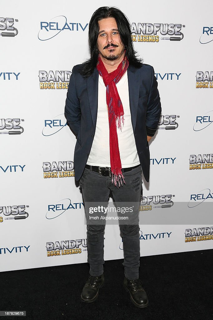 Musician <a gi-track='captionPersonalityLinkClicked' href=/galleries/search?phrase=Gilby+Clarke&family=editorial&specificpeople=614488 ng-click='$event.stopPropagation()'>Gilby Clarke</a> of Guns N' Roses attends the BandFuse: Rock Legends video game launch event at House of Blues Sunset Strip on November 12, 2013 in West Hollywood, California.