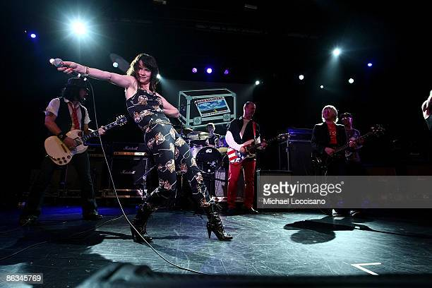 Musician Gilby Clarke singer and actress Juliette Lewis and musicians Wayne Kramer and Carl Restivo perform during the Road Recovery Benefit Concert...