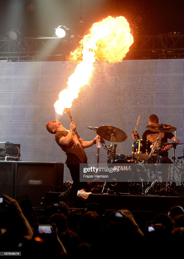 Musician <a gi-track='captionPersonalityLinkClicked' href=/galleries/search?phrase=Greg+Puciato&family=editorial&specificpeople=5721343 ng-click='$event.stopPropagation()'>Greg Puciato</a> of Dillinger Escape Plan performs 5th Annual Revolver Golden Gods Award Show at Club Nokia on May 2, 2013 in Los Angeles, California.