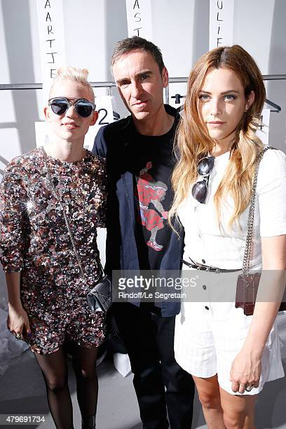 Musician Grimes Fashion Designer Raf Simons and Actress Riley Keough pose Backstage after the Christian Dior show as part of Paris Fashion Week Haute...