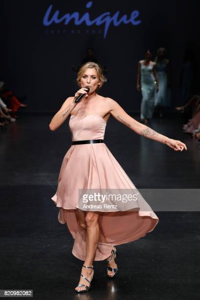 Musician Guilia Wahn performs on the runway at the Unique show during Platform Fashion July 2017 at Areal Boehler on July 22 2017 in Duesseldorf...
