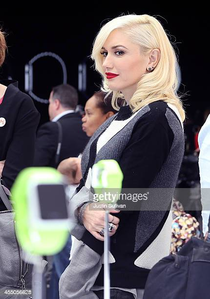Musician Gwen Stefani stands next to a display of the new Apple Watch during an Apple special event at the Flint Center for the Performing Arts on...