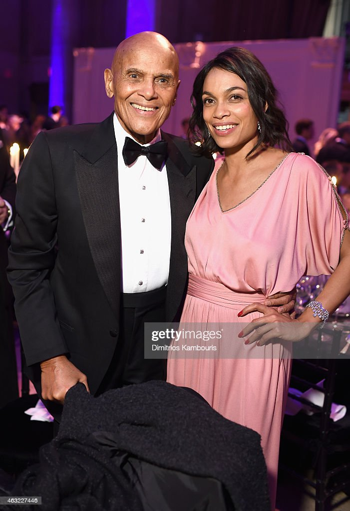 Musician Harry Belafonte (L) and actress Rosario Dawson attend the 2015 amfAR New York Gala at Cipriani Wall Street on February 11, 2015 in New York City.