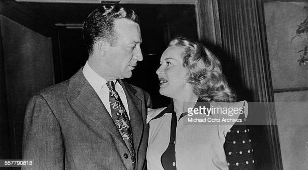 Musician Harry James and his wife actress Betty Grable pose in Los Angeles California