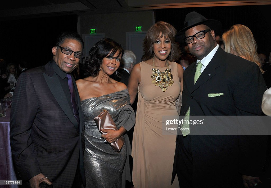 Musician Herbie Hancock Lisa Harris TV Personality Gayle King and Chair Emeritus of The Recording Academy Jimmy Jam arrive Gayle King attends Clive...