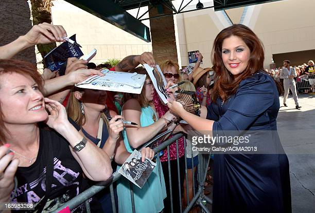 Musician Hillary Scott of Lady Antebellum signs autographs at the 48th Annual Academy of Country Music Awards at the MGM Grand Garden Arena on April...