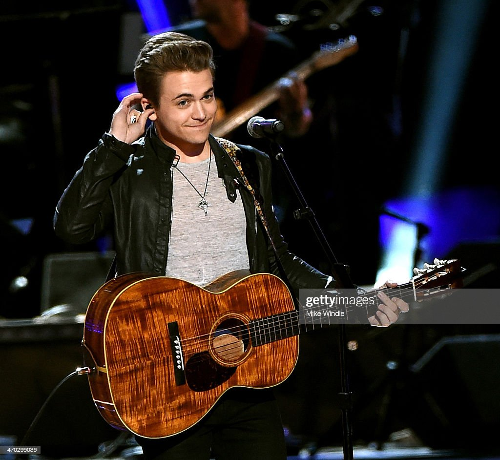 Musician Hunter Hayes performs onstage during ACM Presents: Superstar Duets at Globe Life Park in Arlington on April 18, 2015 in Arlington, Texas.