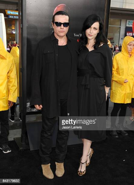Musician Ian Astbury of the band The Cult and wife Aimee Nash attend the premiere of 'It' at TCL Chinese Theatre on September 5 2017 in Hollywood...