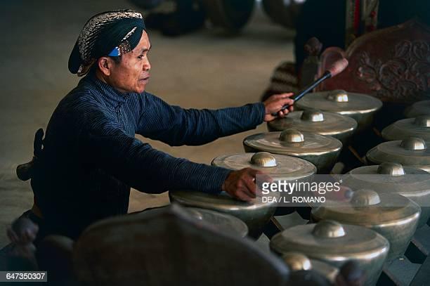 Musician in the gamelan orchestra Wayang Kulit Java Indonesia