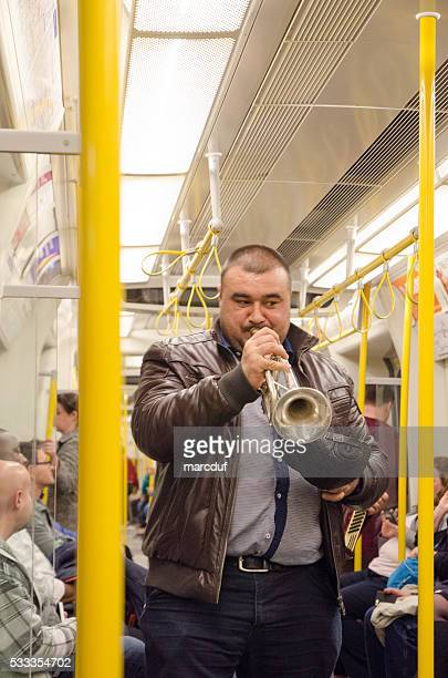 Musician in the wagon of London Subway