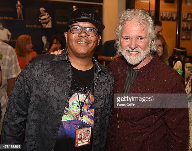 Musician Ivan Neville and musician Chuck Leavell attend Rolling Stone Chuck Leavell Friends PreConcert VIP Party at Bobby Dodd Stadium on June 9 2015...