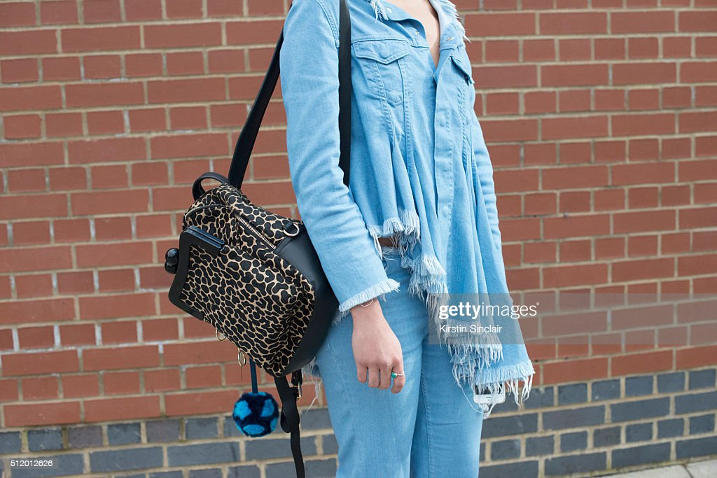 Musician Izzy Bizu wears Marques Almeida jeans and shirt and House Of Holland bag on day 5 during London Fashion Week Autumn/Winter 2016/17 on...