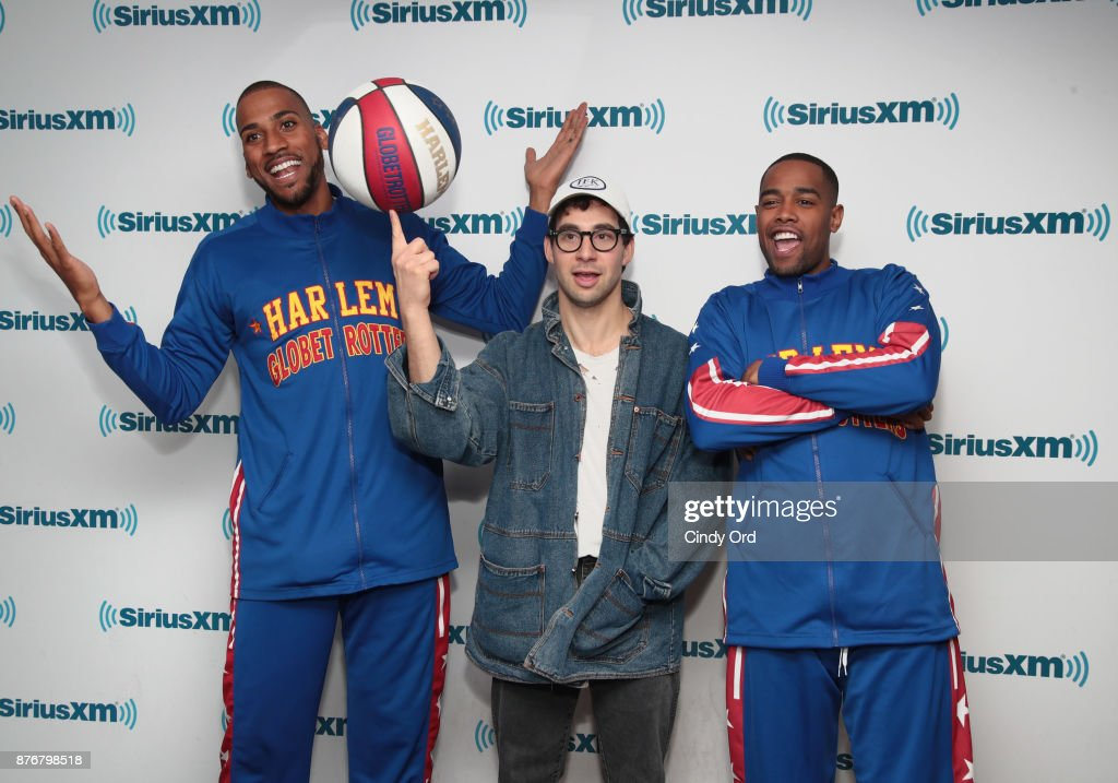 Musician Jack Antonoff practices his basketball moves with Juilan 'Zeus' McClurkin and Brawley 'Cheese' Chisholm of the Harlem Globetrotters during a visit to the SiriusXM Studios on November 20, 2017 in New York City.