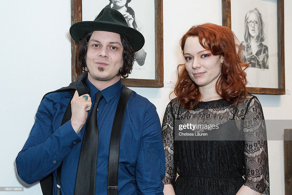 Musician Jack White (L) and artist Mercedes Helnwein attend the opening reception for Mercedes Helnwein's exhibit 'The Trouble With Dreams' at Merry Karnowsky Gallery on October 5, 2013 in Los Angeles, California.