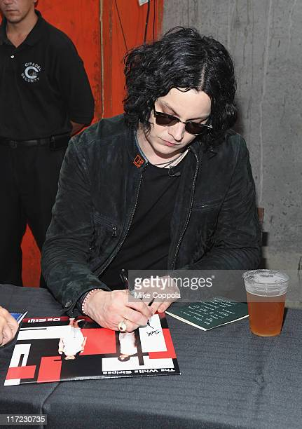 Musician Jack White signs autographs for fans to promote the new record 'Stephen Colbert with the Black Belles' at the Third Man Records Rolling...