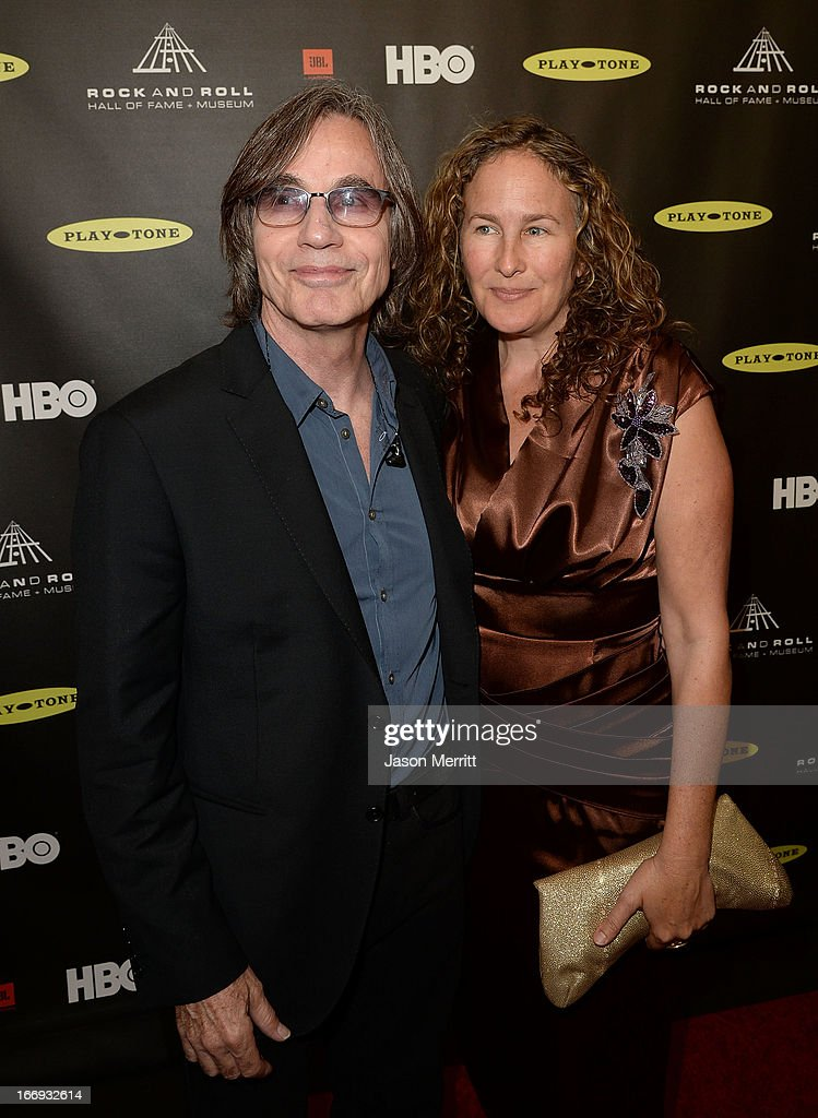 Musician Jackson Browne (R) and wife Dianna Cohen arrive at the 28th Annual Rock and Roll Hall of Fame Induction Ceremony at Nokia Theatre L.A. Live on April 18, 2013 in Los Angeles, California.