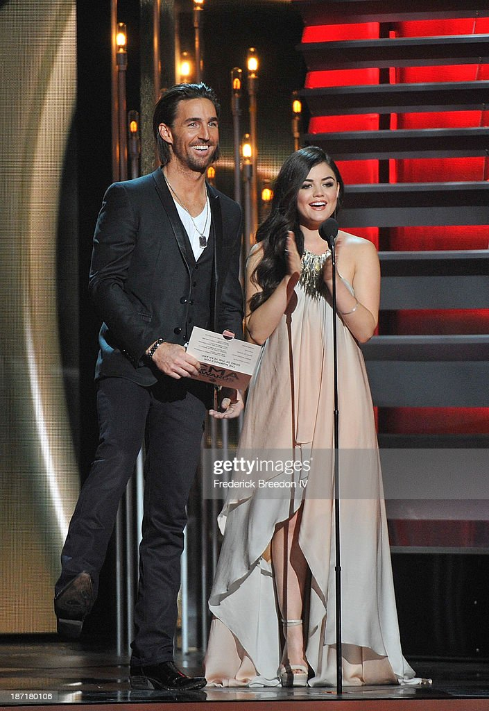 Musician Jake Owen (L) and Actress Lucy Hale (R) on stage during the 47th annual CMA awards at the Bridgestone Arena on November 6, 2013 in Nashville, Tennessee.